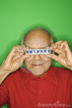 Free Man Holding Pill Organizer Over Eyes. Royalty Free Stock Photos - 2037628
