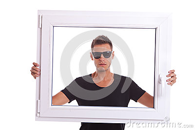 Man holding a pvc window frame