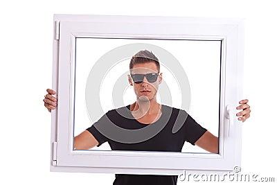 Man holding a pvc window frame