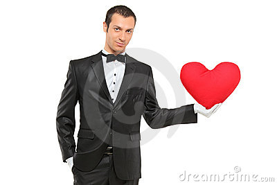 Man holding a red heart-shaped pillow