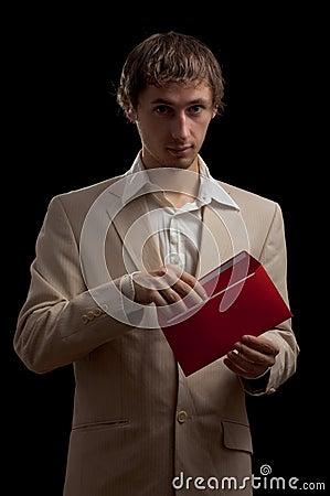 Man holding red letter