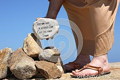 Man holding rock with bible verse John 8:7