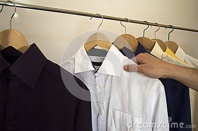 Man holding a shirt