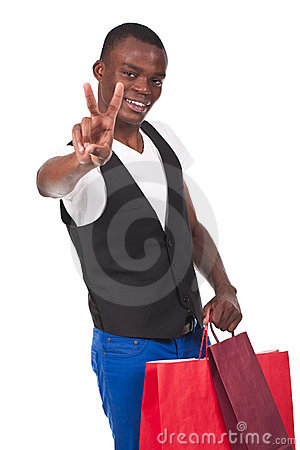 Man holding shopping bags and doing victory sign