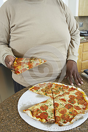 Man Holding Slice Of Pizza
