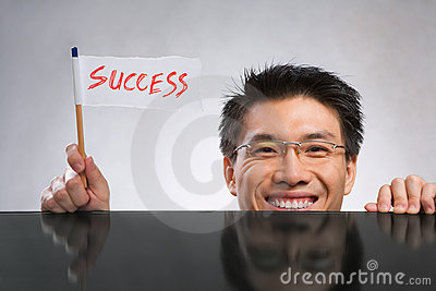 Man holding success flag