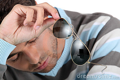 Man holding sunglasses