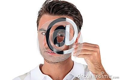 Man holding at symbol