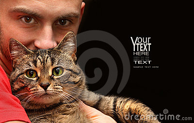 Man holding tabby cat