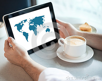 Man holding tablet computer in cafe