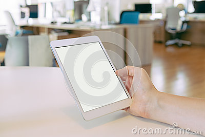 Man holding tablet pc in the office