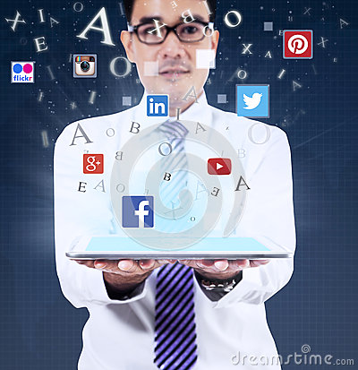 Free Man Holding Tablet With Social Media Symbols Royalty Free Stock Image - 60013626