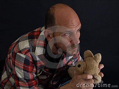 Man Holding a Teddy Bear