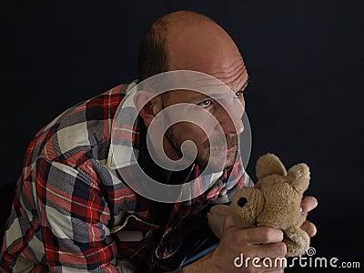 Man Holding a Teddy Bear