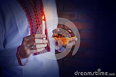 Man holding traditional ramadan food at night Stock Photo