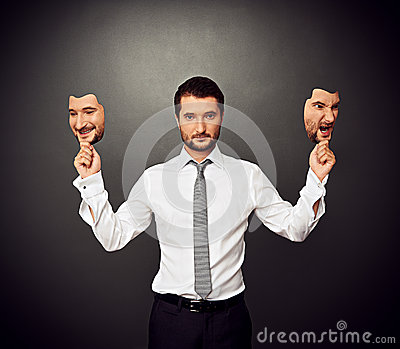 Man holding two masks with different mood