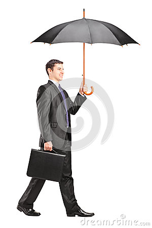 Man holding an umbrella and briefcase