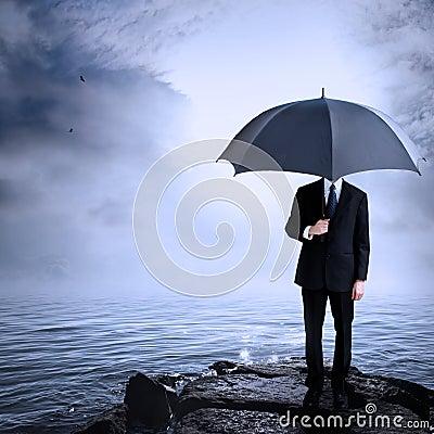 Man Holding Umbrella at the Coast