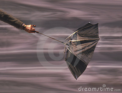 Man holding umbrella in wind