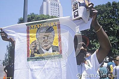 Man holding up Nelson Mandela t-shirt, Editorial Photo