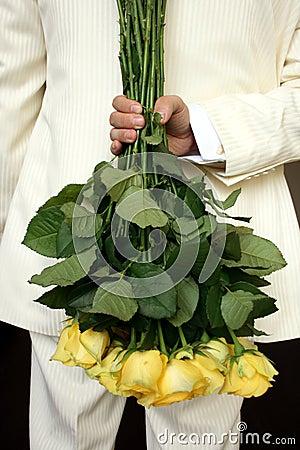 Man holding yellow roses