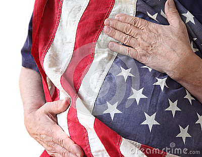 Man holds American flag close to his body