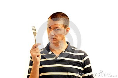 Man holds fork - symbol of potential