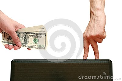 Man holds in his hand a hundred dollars and pays