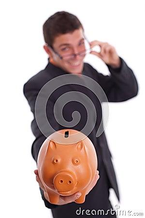 Man holds a piggy bank