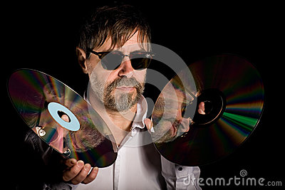 Man holds a retro laser discs