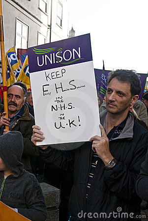 Man holds up a UNISON placard saying Editorial Stock Image