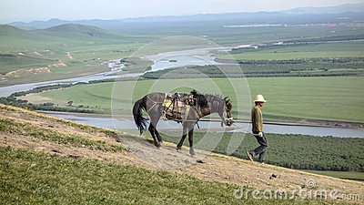 Man and a horse Editorial Stock Image