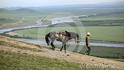Man and horse Editorial Photo