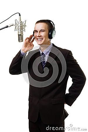 Man host at radio station speak to microphone