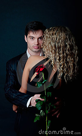 Man hug his woman and holding rose