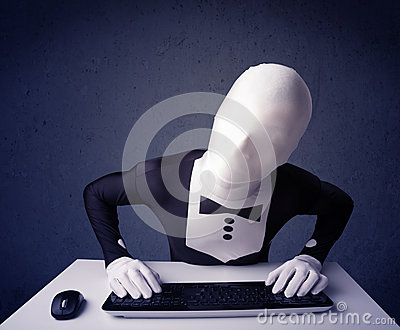Man without identity working with keyboard on blue background