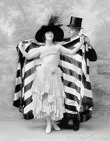 Free Man In A Top Hat Helping A Woman Into A Cape Stock Image - 52027051