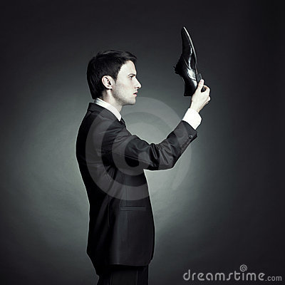 Free Man In An Elegant Suit And Shoes In Hand Royalty Free Stock Image - 17106336