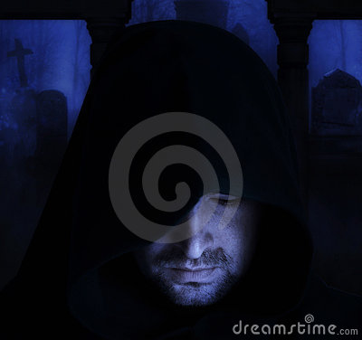 Free Man In An Medieval Hood On A Churchyard Royalty Free Stock Photography - 19881207