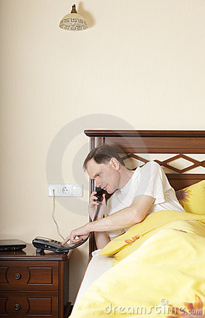 Free Man In Bed Calling By Phone Stock Images - 10852254