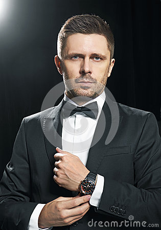 Free Man In Black Suite Whit Watch Stock Photography - 67474002