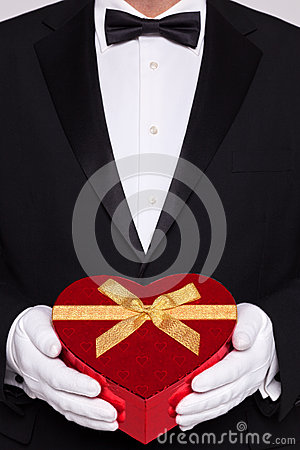 Free Man In Black Tie Holding A Heart Shaped Box Of Chocolates Royalty Free Stock Photo - 29083105