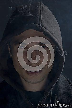 Free Man In Darkness Smoking Stock Images - 12085684