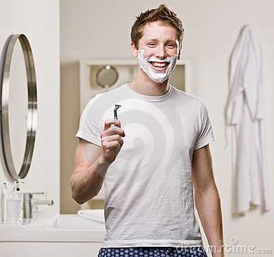 Free Man In Pajamas In Bathroom Shaving Stock Images - 6601864
