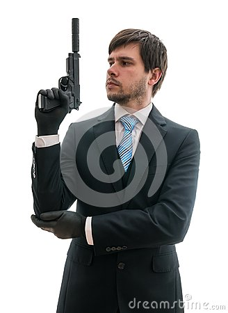Free Man In Suit Holds Pistol With Silencer In Hand. Isolated On White Background Royalty Free Stock Images - 77479269