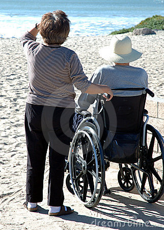 Free Man In Wheelcheair At The Beach Stock Images - 355414