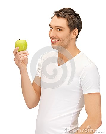 Free Man In White Shirt With Green Apple Stock Image - 25537981