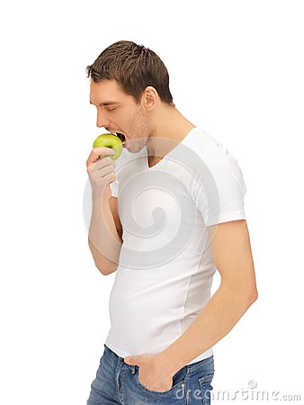 Free Man In White Shirt With Green Apple Royalty Free Stock Photos - 39715228