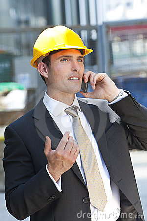 Man In Industrial Hard Hat Talking On Cell Phone