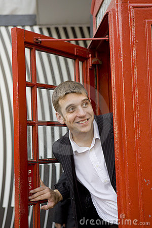 Man inside traditional English red booth
